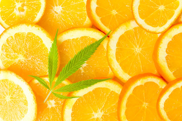 Orange fruit slices and marijuana leaf