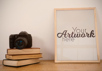 Picture Frame Mockup with Camera and Books
