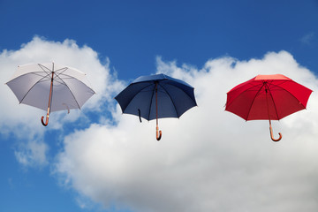 Floating Umbrellas in White, Dark Blue and Red