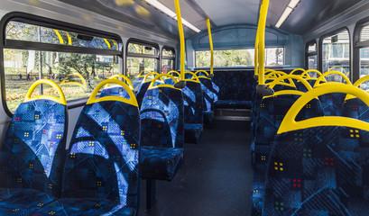 Empty top floor of a London double-decker bus