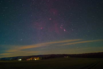 The Orion Constellation including Barnard's Loop, the Orion Nebula, the Flame Nebula, and the Rosette Nebula as seen from Lemfoerde in Germany.