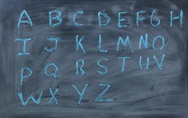 English alphabet letters written on chalk board