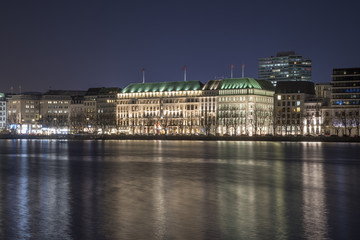 nightly panorama over the lake Alster into the city of Hamburg Germany