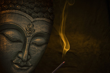 Buddha image with incense