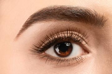 Beautiful young woman with eyelash extensions, closeup