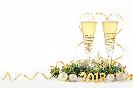 New Year Celebration with Champagne Glasses 2018. New Year golden ribbon flutes with bubbling champagne on white background.