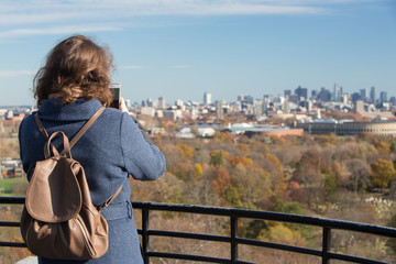 People looking at city from view point at fall