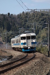 The local train running in the rural area on sunny day in Japan.