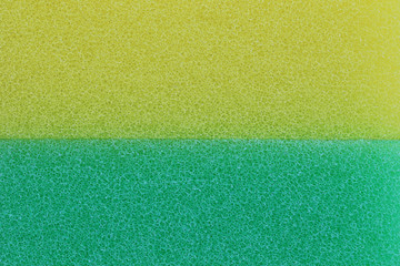 Green and yellow sponge surface background.
