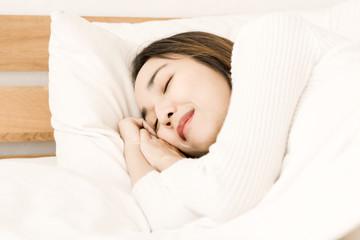 women sleep on bed in bedroom