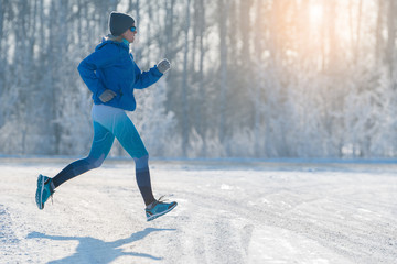 Winter Jogging - Winter Running in Snow. A healthy lifestyle.
