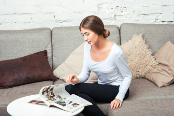 Young woman reading magazine