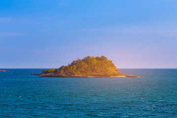 Beauty sunset ovet alone island over ocean skyline, natural landscape background