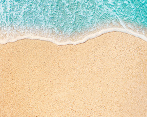 Sea Beach and Soft wave of blue ocean. Summer day and sandy beach background. Copy space of summer...
