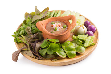 """Shrimp paste the ingredients of """"nam prik gapi"""" Thai flavors food, Chili dip and vegetable isolated on white background"""