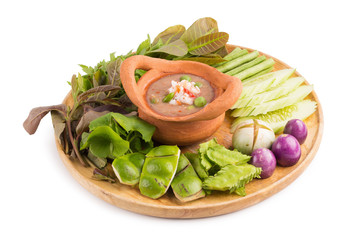 "Shrimp paste the ingredients of ""nam prik gapi"" Thai flavors food, Chili dip and vegetable isolated on white background"