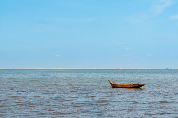 One lonely wooden fishing boat in sea