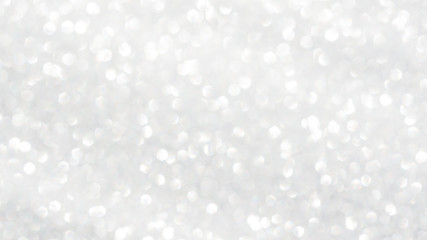 white glitter and bokeh for a background.