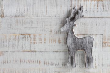 Weihnachten - Holzintergrund mit Rentier