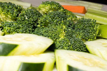 Broccoli Heads, Cucumber Slices and Celery Sticks on a Plate