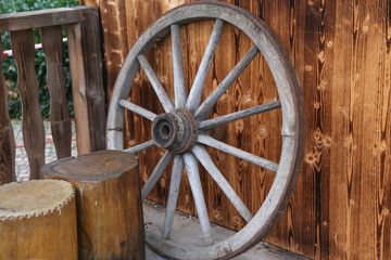 An old wooden wheel from a cart