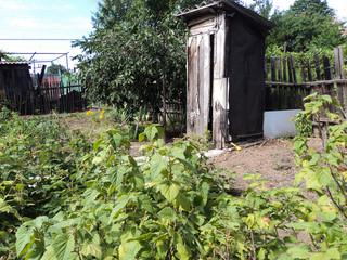 village wooden toilet outside