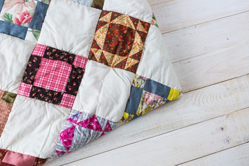 Part of color patchwork quilt as white wooden background. Colorful blanket in style patchwork close up. Handmade. Fototapete