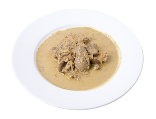 Meat in white sauce.