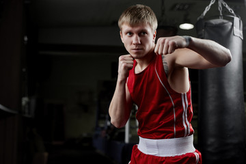 Boxing. Portrait of a boxer on the background of the gym
