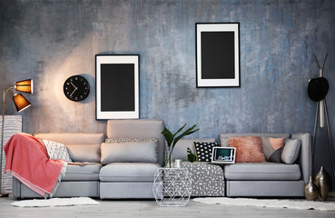 Modern living room design with grey couch