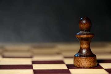 Chess figure on a chessboard on a dark background close up