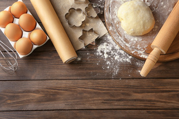 Ingredients for dough on wooden background
