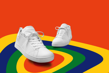 Pair of White sneaker composition like dancing on color full spin cicle  background with clipping path