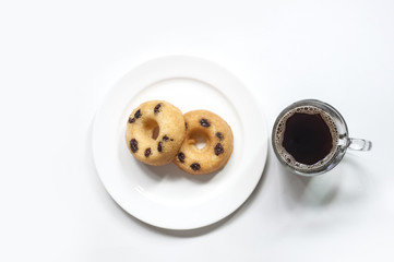 A coffee cup and donut on white background