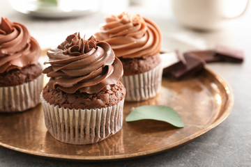 Tasty chocolate cupcakes on metal tray