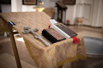 Golden religious utensils - Bible, cross, prayer book, missal. Details in the Orthodox Christian Church. Russia.