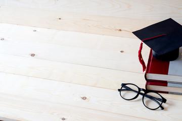 Graduation cap above books