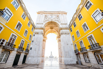 View on the Triumphal arch on the Commerce square during the sunrise in Lisbon city, Portugal