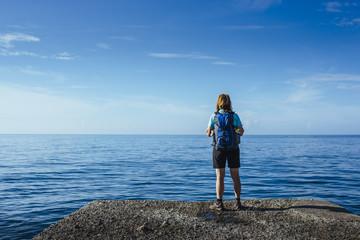 Female hiker with blue daypack on the amalfi coast / Salerno, italy, europe