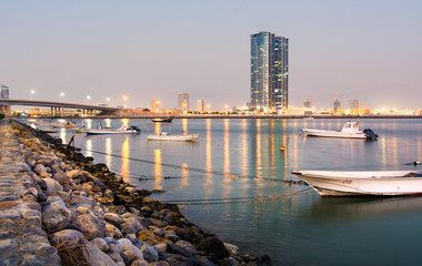 Ras Al Khaimah creek with city view at dusk
