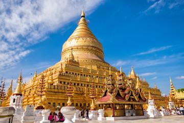 Bagan, Myanmar - December 6, 2014: Burmese people pray and worship at Shwezigon Paya, one of Myanmar's most revered pagodas, in Bagan, Myanmar (Burma).