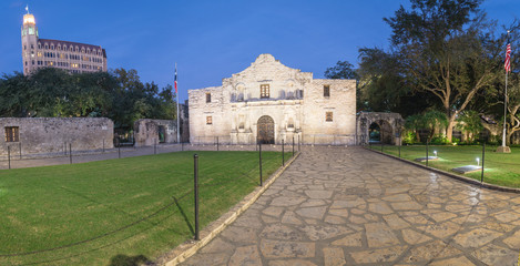 Panorama view the Alamo Mission in San Antonio at blue hour. It is commonly called The Alamo and was known as Misión San Antonio de Valero. A top-rated, rich colonial heritage tourist attraction
