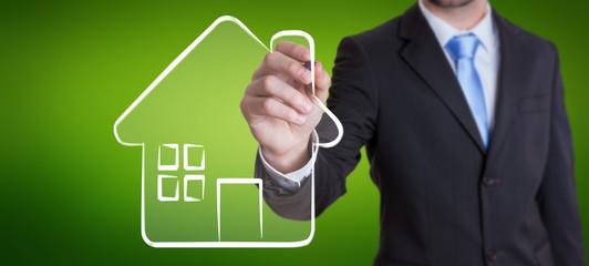 Businessman drawing manuscript real estate plan project