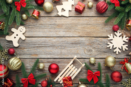 Fir Tree Branches With Christmas Decorations On Wooden Table Stock