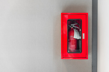 fire extinguishers cabinet on grey wall background in office building