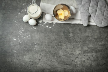 Kitchen utensils and food ingredients on grey background