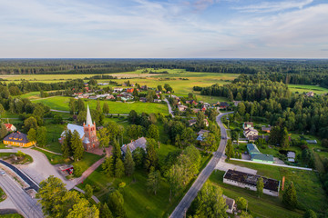 Aerial view of catholic church at sunset. Beautiful sunset at countryside.