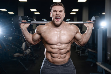 Brutal strong bodybuilder athletic men pumping up muscles with dumbbells.