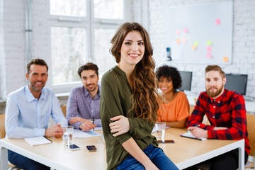 Group of happy students in classroom