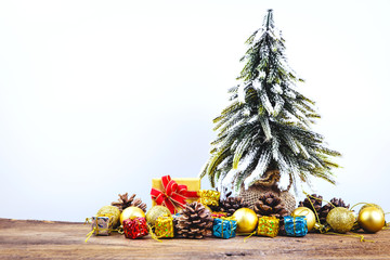 Christmas or New Year background with pine cones,gift box,golden ball and pine tree of Xmas decorations and fir branches, blank space for a greeting text on white